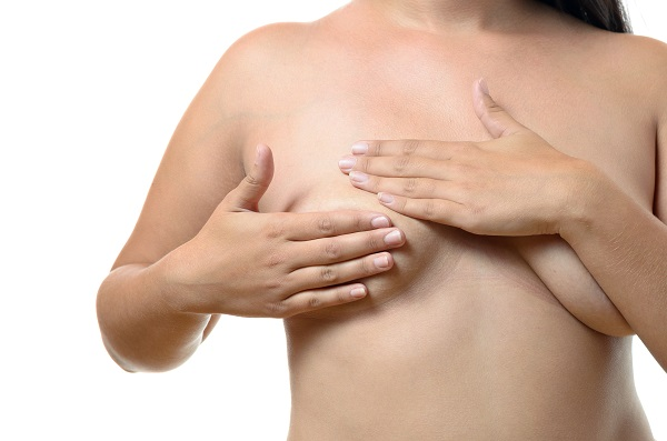 Woman Hiding Her Tubular Breasts With Her Hands